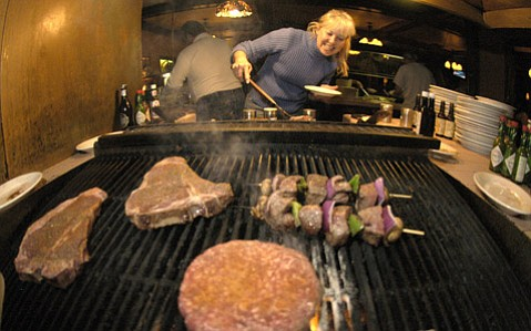 <b>MEAT YOUR WAY:</b>  There will be no complaining about overdone steaks at The Palms in Carpinteria, where patrons cook their own food.