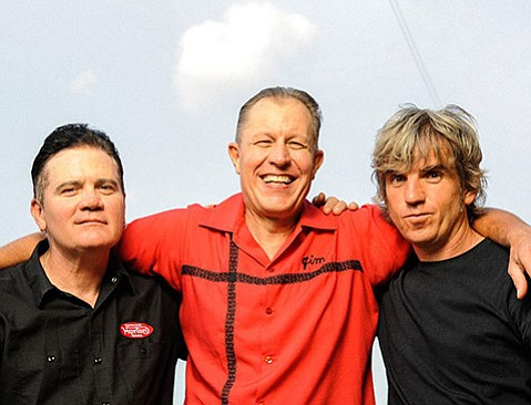 <strong>OUTLAW COUNTRY:</strong> The Reverend Horton Heat (center) and his band honor the Man in Black at Roadshow Revival, a tribute to Johnny Cash.