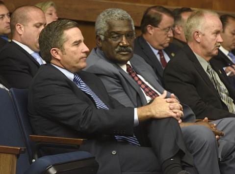Corizon executive Harold Orr (center)