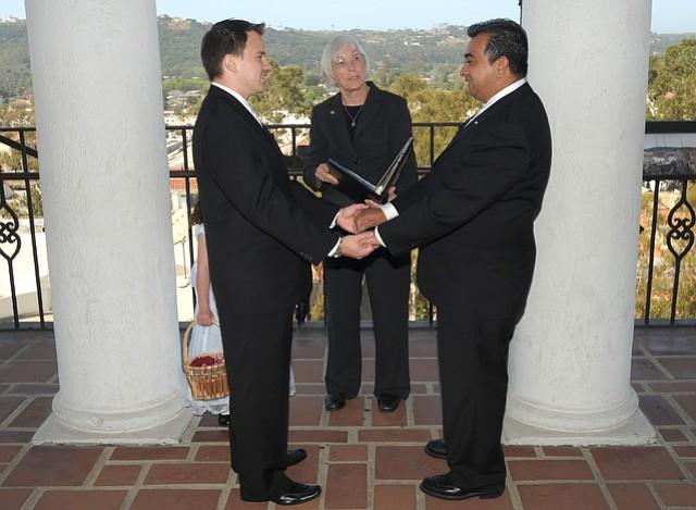 WEDDING BELLS: Mayor Marty Blum officiates the marriage of Andy and Manny Edgar-Beltran. (June 17, 2008)