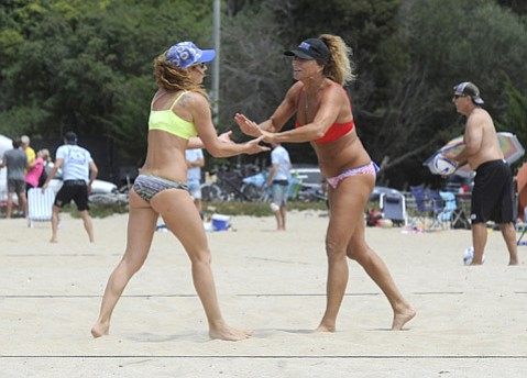 <b>BALLS OF FIRE:</b> Passionate volleyballers Vladia Vignato (left) and Marla O'Hara spiked and set in the sand of East Beach.