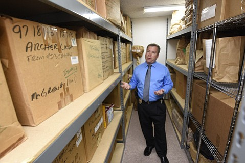 <b>LOOSE LIPS:</b>  Detective Andy Hill — shown here in the police department's Dead Room with 20 boxes' worth of evidence — has a knack for getting people to talk.