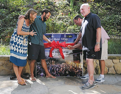 <b>DRINK ME:</b> Jack (second from left) and Kim (far left) Johnson donated a free water station to the Bowl as a reward for winning Jack Johnson's All At Once Sustainability Award late last year.