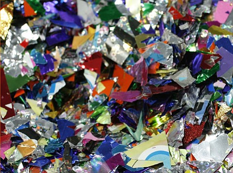 Seen here, cascarones confetti is made of Mylar, cellophane, glitter, paint, glues, dyed paper, and crushed eggs.