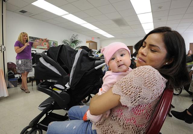 Monica Tello with daughter Madelynne listens to Meg Beard, Breastfeeding Coordinator for WIC (left).