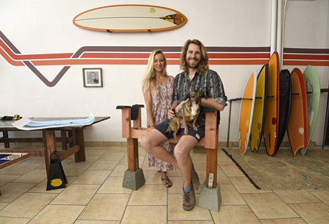 <b>SHAPE-SHIFTER:</b> Ryan Lovelace sells boards, girlfriend Katie McLean sells clothes, and Herbie the dog just chills in their new surf shop on Parker Way.