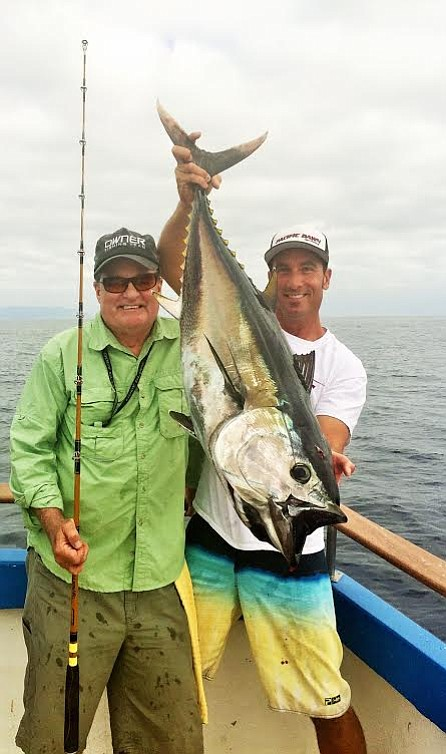 <b>FINE FISHING:</b>  Juan Vega (left) caught a 56-pound blue fin aboard Bill Cavanaugh's <i>Amigo</i>.