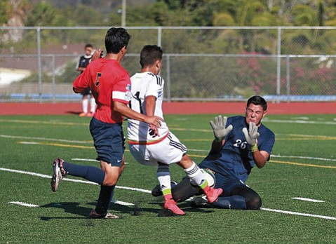 <b>SHOT BLOCKERS: </b> Excitement was steady in San Marcos High's Warkentin Stadium during last weekend's friendly match between the Santa Barbara Soccer Club and Mexico's U-17 team. Above, S.B. goalkeeper Lalo Delgado blocks a shot by Mexico's Kevin Lara as Delgado's red-shirt-wearing teammate Francisco Arroyo shows up in defense.