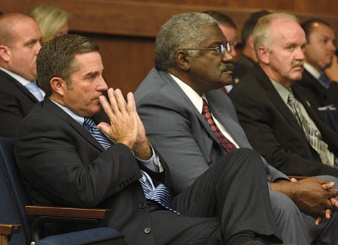 <b>Jail Conflict:</b>  Corizon executives Jonathan Walker (left) and Harold Orr (center) appeared before the supervisors in June, when the supes delayed renewing the correctional health-care contract.
