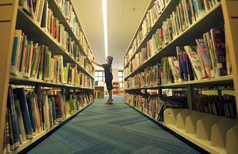 <b>TAKE A LOOK:</b> Apollo Cadiente browses in the Santa Barbara Central Library's newly reopened Children's Library.