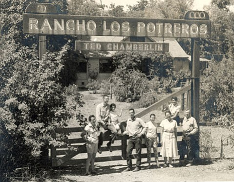 The Chamberlin family in 1957: (from left) Helen, Willy, Sarah, Fred, Chantal (a French exchange student), Ailie, Debi (on the gate), and Ted.
