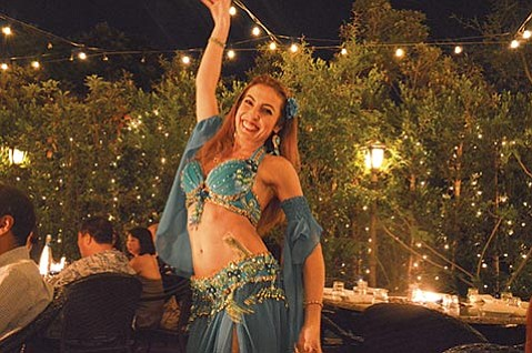 <b>MOVER AND SHAKER:</b>  Each Saturday, Cris Basimah graces Zaytoon diners with a 30-minute dance set of flirtatious hip drops, shoulder snaps, shimmies, a sword dance, and classic belly-dance undulations and body rolls.