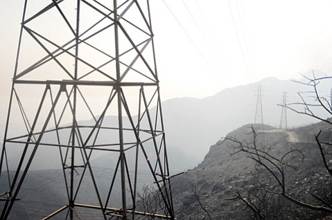 <b>AT RISK? </b> Power lines stand over charred earth after the Jesusita Fire.
