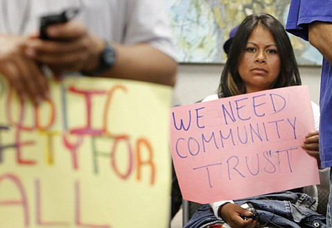 <b>RALLIER: </b> Miriam Montoya holds a sign during the County Supervisors meeting on the detention process for undocumented immigrants.
