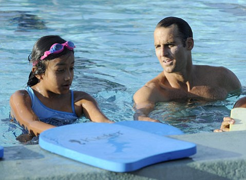 Wolf Wigo is serving as an ambassador for the sport to kids like Wendy Figueroa, who wouldn't otherwise be so comfortable in the pool.