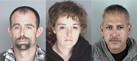 Matt Crandall (far right) fled authorities when Travis Grant (left) and Sabrina Ceglia (middle) were arrested Wednesday for possessing a stolen Habitat for Humanity truck and other stolen property.