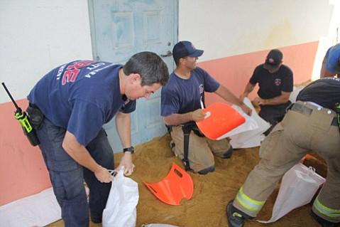 Santa Barbara City Firefighters filled sandbags Saturday at the City's free sandbag event in preparation for El Niño.