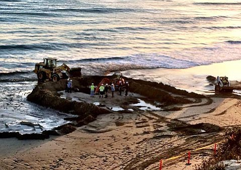 Crews with the State Lands Commission work on capping leaky Becker Well at Summerland Beach.