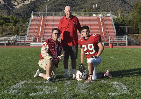 <strong>GENERATIONS OF GRIDIRON:</strong> Tim Jimenez Jr. (right) is carrying on the Carp High football traditions of his family, including his uncle Tony Jimenez Jr., who played for Coach Lou Panizzon (center) in the 1970s.