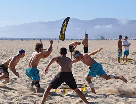 <strong>Sun and Fun:</strong> The new beach and lawn sport is catching on with college kids and others.