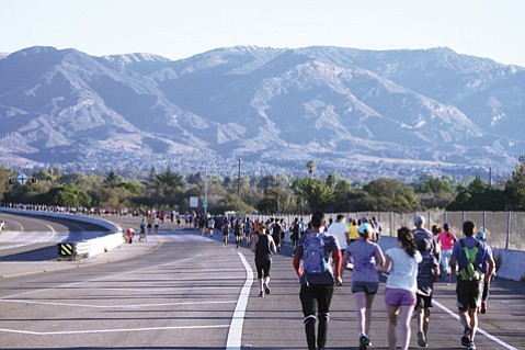 <strong>ZOOM:</strong> Some 2,500 runners merged onto Highway 217 as they set out for the Santa Barbara Veterans Day Half Marathon.