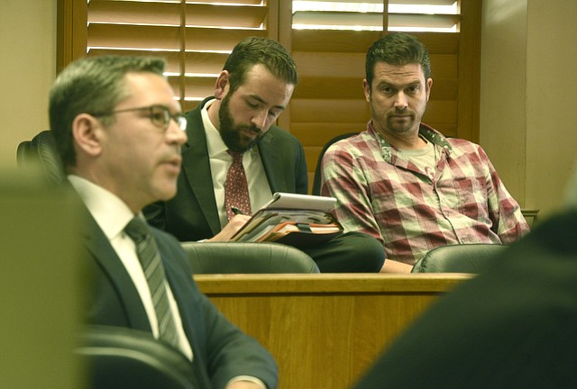Christian Garvin (far right) sits in court next to defense attorney Stephen Dunkle (center) and prosecutor Brian Cota. (Nov. 10, 2015)