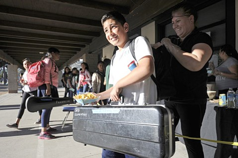 <strong>CHEESE, PLEASE:</strong> Larry Bermudez grabs nachos after class at Franklin Elementary School.