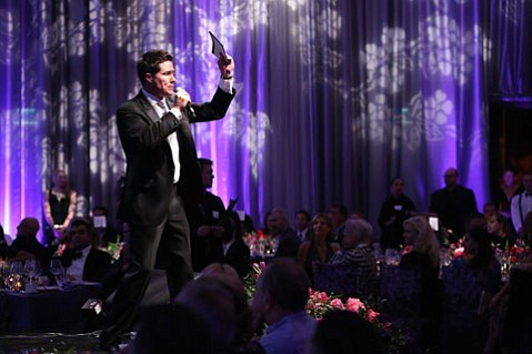 "Andrew Firestone from ""The Bachelor"" served as the gala's live auctioneer."