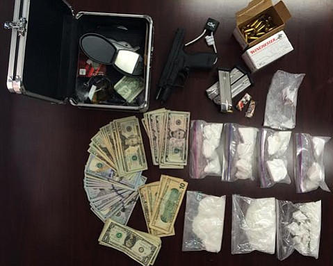 Authorities seized over a pound of cocaine, a semi-automatic gun with ammunition, an illegal belt-buckle knife, and a large sum of cash from the alleged cocaine dealer's Carpinteria home.