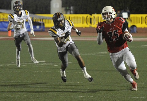 <strong>BEAST MODE:</strong> Bishop Diego running back John Harris (#25) breaks loose for big yardage in the fourth quarter Friday night. Harris gained 159 yards in Bishop's 53-47 victory over Newbury Park.