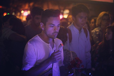 <strong>SCARY STUFF: </strong> A mourner blows on incense at a vigil for Andres Sanchez, who died after ingesting N-Bomb (below).