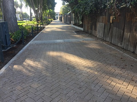 The road that allows parks workers to access Plaza Vera Cruz was redone with permeable pavers to allow more rainwater infiltration and less runoff.