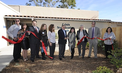 <strong>SNIP:</strong>  Mental-health planners hope the new Crisis Stabilization Unit can reduce the number of mentally ill people needing involuntary psychiatric treatment or seeking emergency room help. Among movers and shakers at the ribbon-cutting ceremony were Sheriff Bill Brown (third from left), Supervisor Salud Carbajal (fifth from right), Supervisor Janet Wolf (holding scissors), and Supervisor Steve Lavagnino (second from  right).