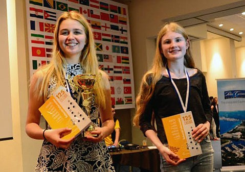 Agata Bykovstev (left) is all smiles after placing third out of 95 female chess player in her age division at the World Youth & Cadets Chess Championship at Porto Carras Resort in Greece.