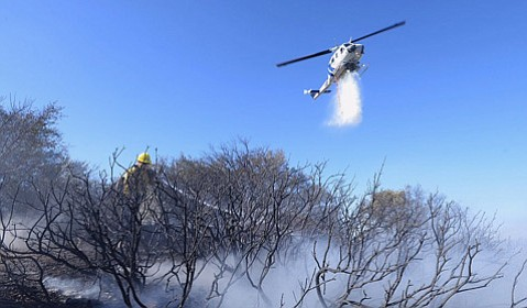 County firefighters and first responders from the Los Padres Forest Service battled a 3/4-acre vegetation fire on Sunday off of West Camino Cielo.
