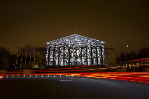"""After the terror attacks, the French government shut down the vast majority of planned protests out of safety concerns. The last minute workarounds by artists and activists, such as the """"Standing March"""" projection on the Assemblee Nationale by French artist JR and American filmmaker Darren Aronofsky, has been nothing short of brilliant."""