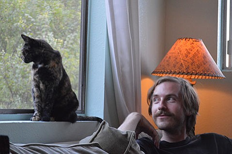 <b>FELINE FLUXUS:</b> Sean McCann, with cat Heather, uses inter-media and minimalist principles to guide his avant-garde compositions.