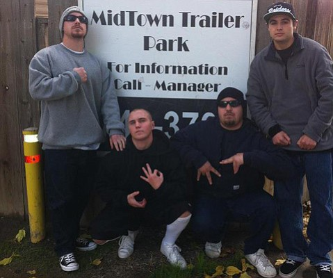 <strong>RIFT:</strong> Murder victim Kelly Hunt (second from left) flashes gang signs next to Isaac Jimenez (far right), who is accused of murdering him.