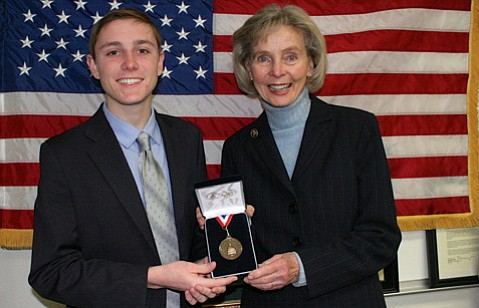 Kai Fisher, 17, granted Congressional Bronze Medal for personal achievement.