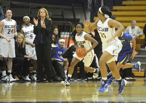 <strong>TURNING IT AROUND:</strong> Onome Jemerigbe (#10 with ball) and Chaya Durr (#21) are off to the races during UCSB's 93-78 victory over Morehead State, as Gaucho coach Bonnie Henrickson applauds.