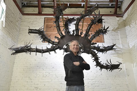 <strong>THE MAN, THE MYTH:</strong>  David Shelton is pictured with his magnificent hydra. This is the first piece in a monument that will one day rule the corner of Garden and Ortega streets.