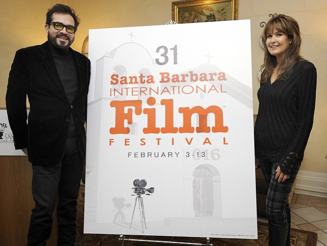 SBIFF execitive Director Roger Durling unveils the 2016 poster with artist Barbara Boris who has designed the posters for the past 13 years (Jan. 12, 2016)