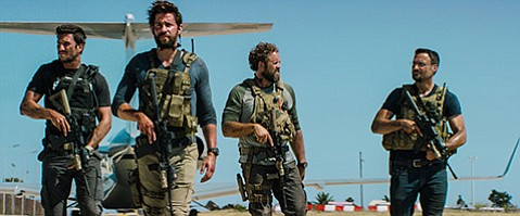 <b>THE HOURS:</b>  John Krasinski (second from left) plays Jack Silva in Michael Bay's <b>13 Hours</b>.
