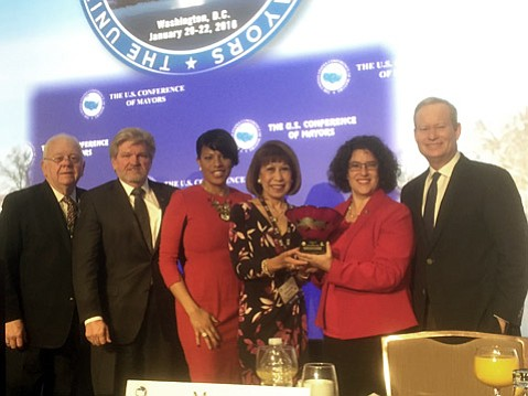 Mayor Helene Schneider accepts a national award for local arts leadership at the U.S. Conference of the Mayors' annual winter meeting.