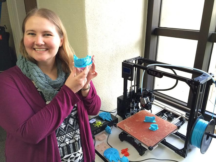 Tacy Kennedy and a model of the <em>Homo naledi</em> jawbone she made at the downtown library's Makerspace.