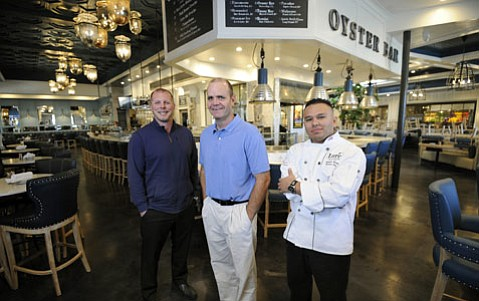<strong>FRESH-CAUGHT:</strong>  Lure is already catching lots of attention, thanks to (from left) GM Robert Schneider, owner David Cortina, and managing chef Roberto Ucan.