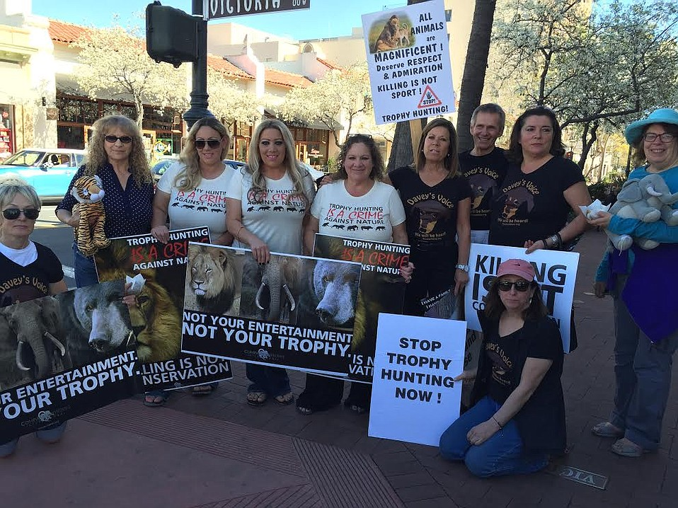Protesting trophy hunting, activists brought the Worldwide Rally for Cecil to State Street.