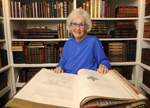 <strong>KNOWLEDGE IS POWER:</strong>  Sara Miller McCune sits at home with her rare book collection.