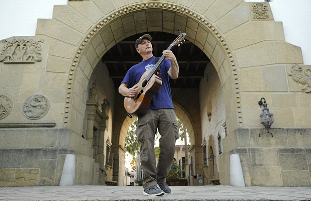 Bruce Goldish playing guitar at the Santa Barbara Courthouse. (March 16, 2015)