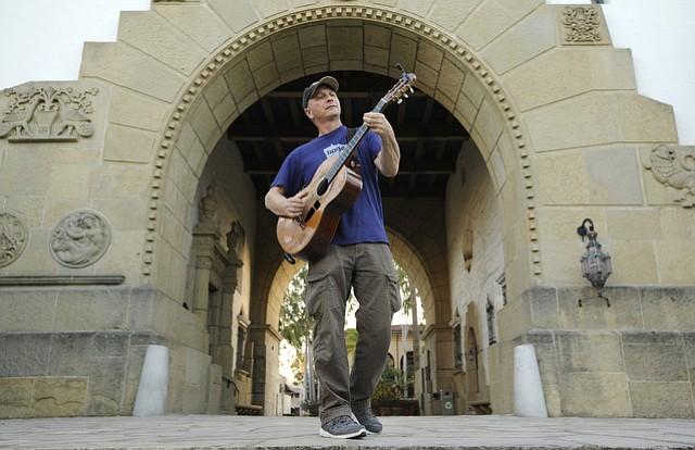 Bruce Goldish playing guitar at the Santa Barbara Courthouse. (March 16, 2015)